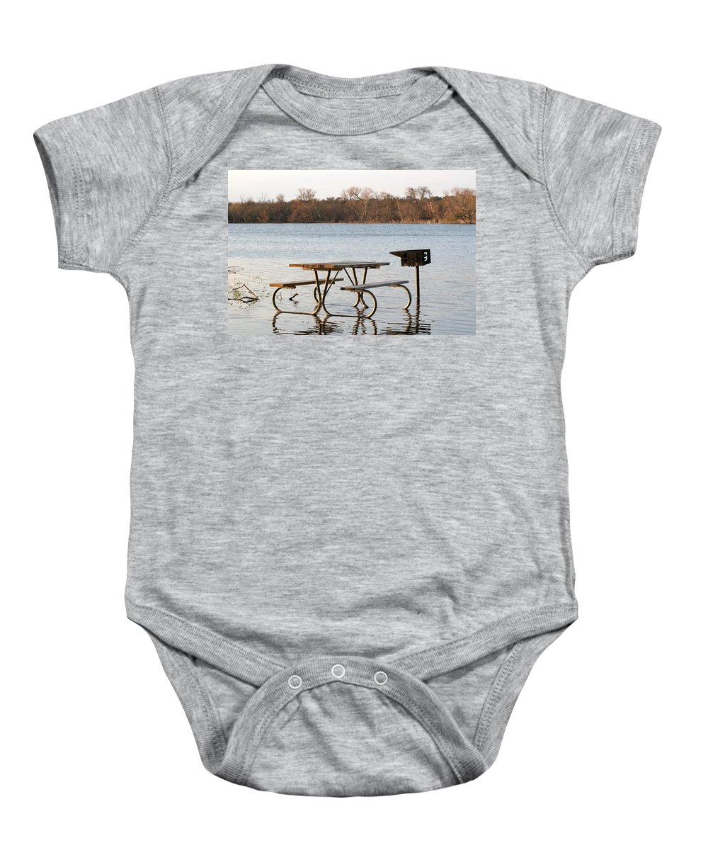 Flood Baby Onesie featuring the photograph Flooded Park Bench Lunch by Ian Mcadie