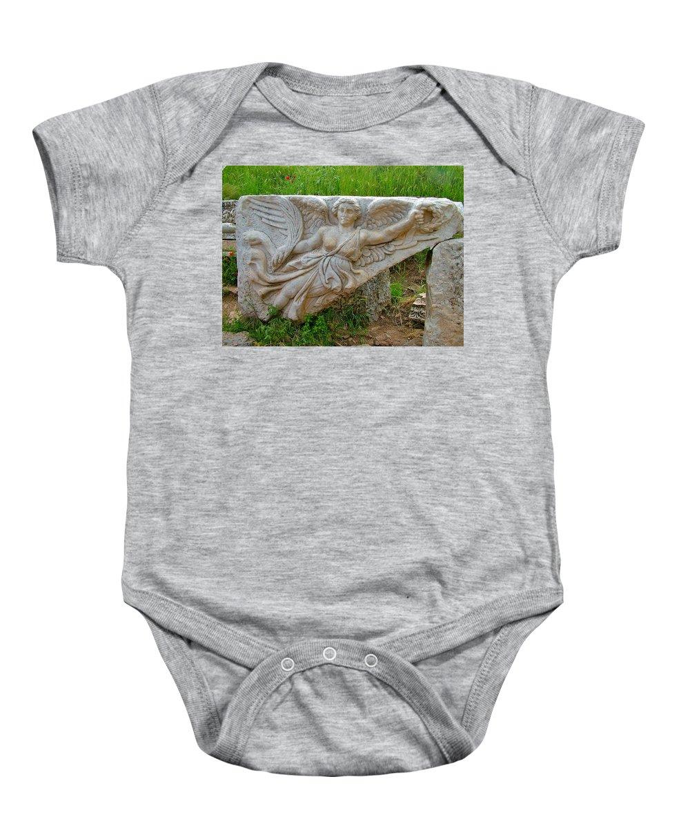 Flying Angel In Ephesus Baby Onesie featuring the photograph Flying Angel In Ephesus-turkey by Ruth Hager