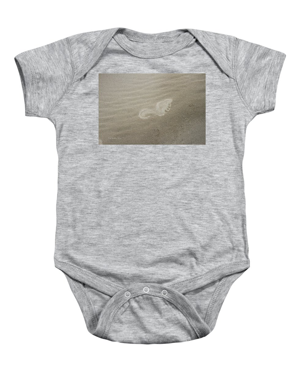 Foot Print In The Sand Baby Onesie featuring the photograph Foot Print In The Sand by Tom Janca