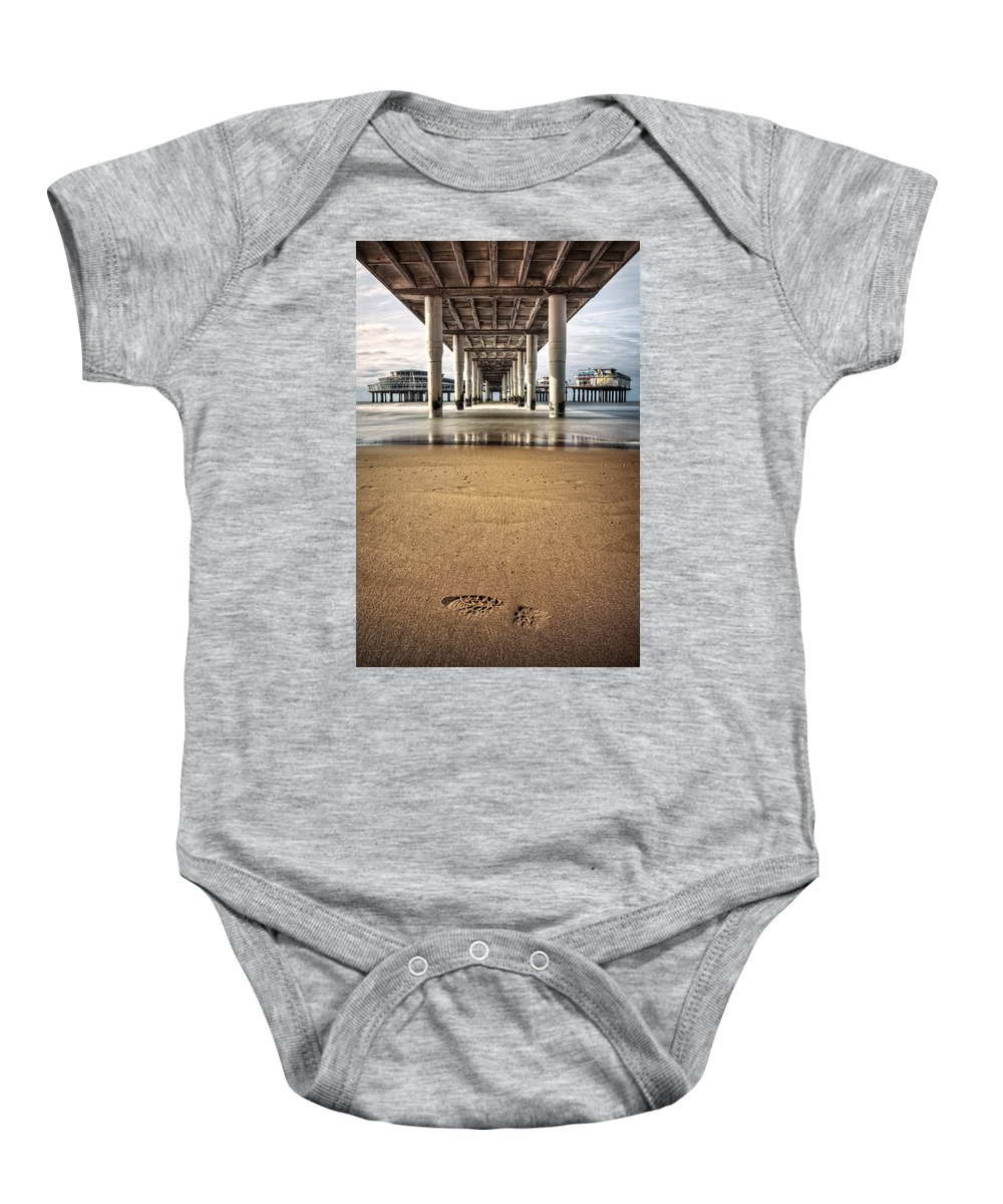 Piers Baby Onesie featuring the photograph Footprints In The Sand by Dave Bowman