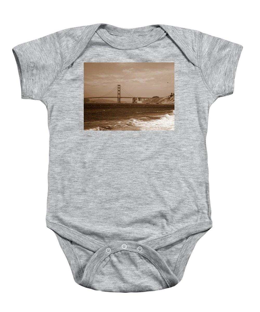 Golden Gate Bridge Baby Onesie featuring the photograph Golden Gate Bridge With Surf Sepia by Carol Groenen