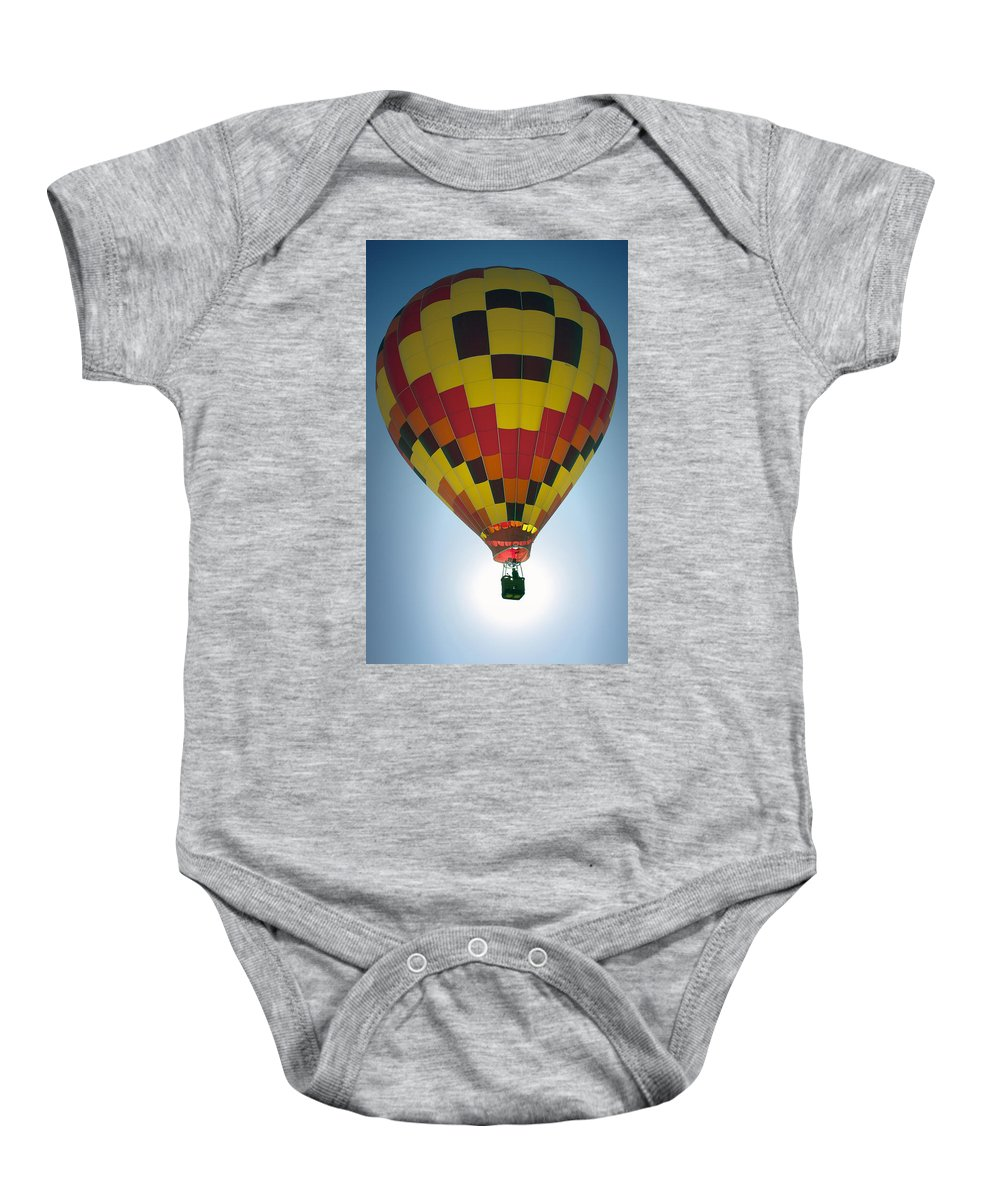 Hot Air Balloon Baby Onesie featuring the photograph Hav A Nice Day by Fred Hahn