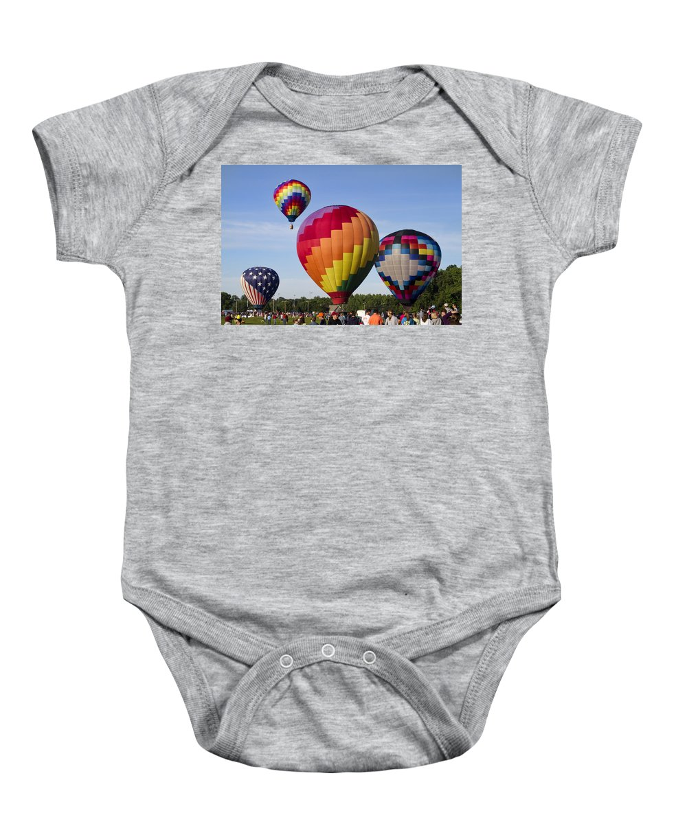 Hot Air Balloons Baby Onesie featuring the photograph Hot Air Balloon Festival In Decatur Alabama by Kathy Clark