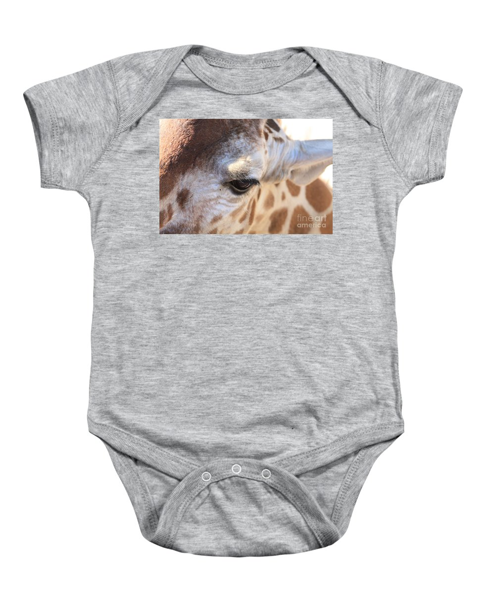 Giraffe Baby Onesie featuring the photograph I See You by Brandi Maher