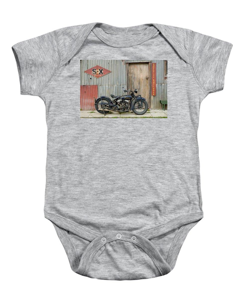 Classic Baby Onesie featuring the photograph Indian Chout At The Old Okains Bay Garage 2 by Frank Kletschkus