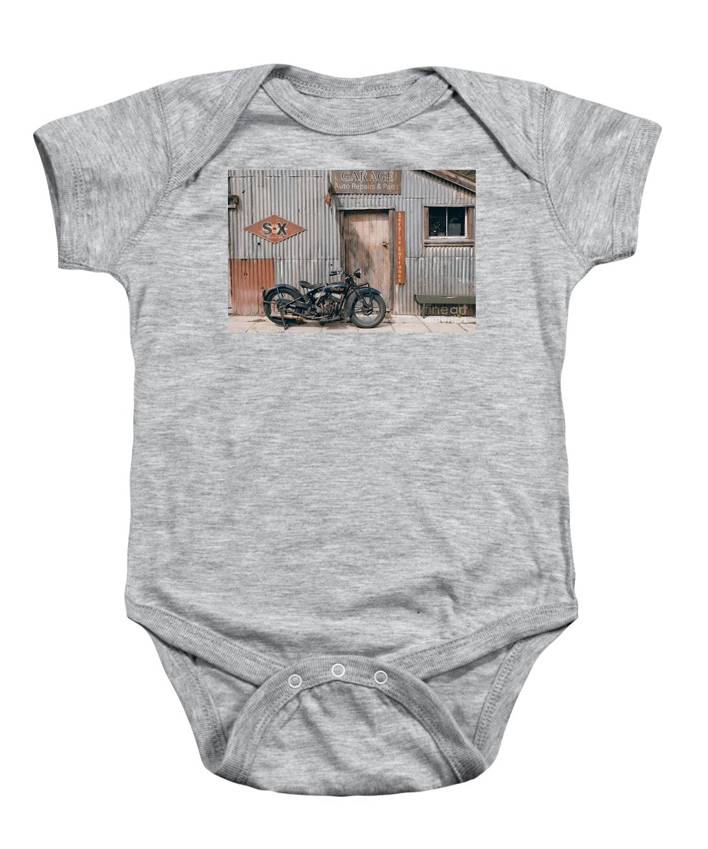 Classic Baby Onesie featuring the photograph Indian Chout At The Old Okains Bay Garage 3 by Frank Kletschkus