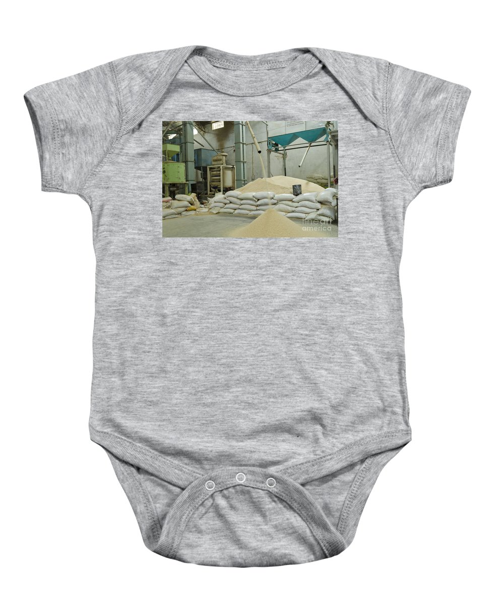 Raw Baby Onesie featuring the photograph Indian Rice Mill by Image World