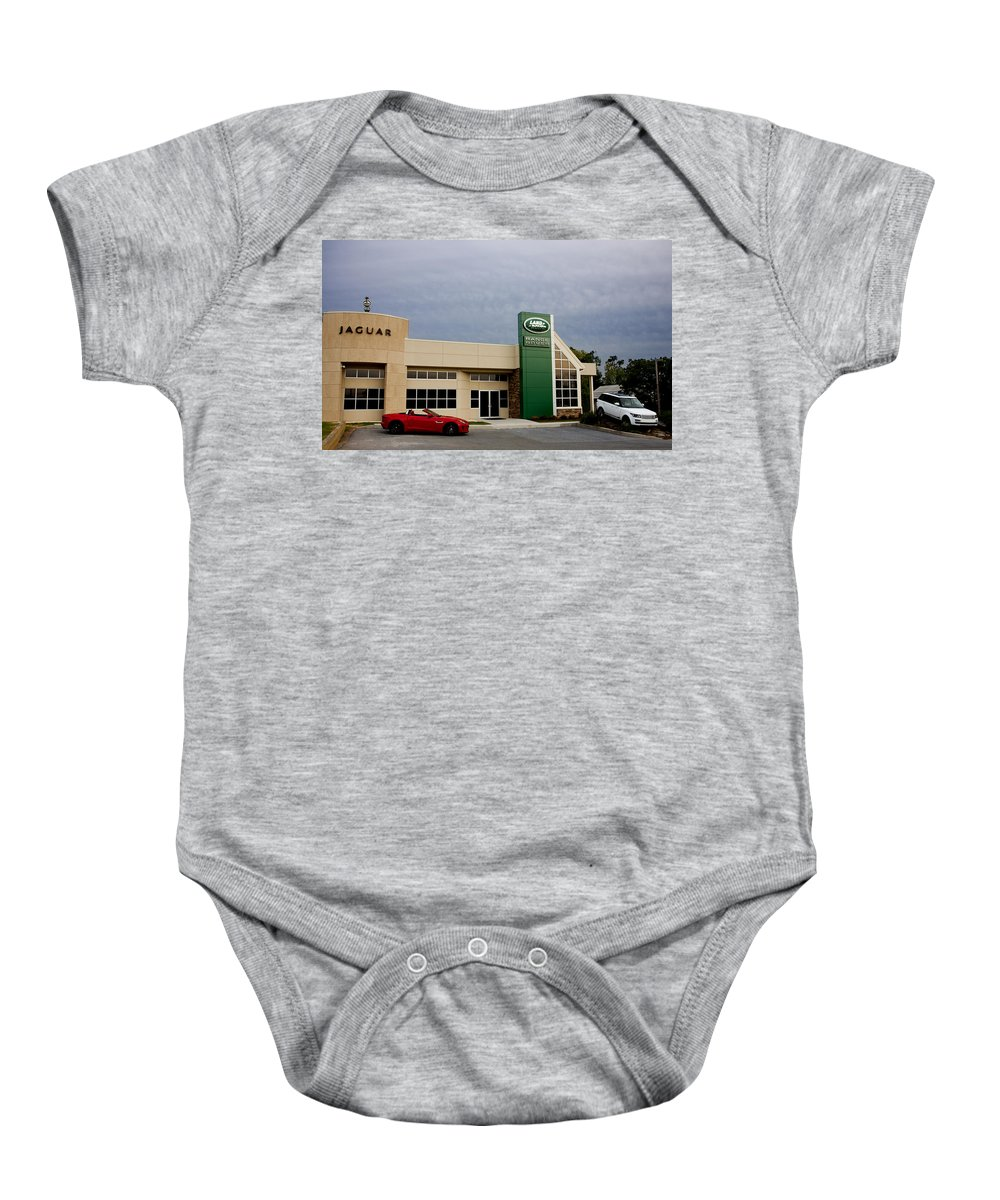 Jaguar Baby Onesie featuring the photograph Jaguar Land Rover At Dusk by Jean Macaluso