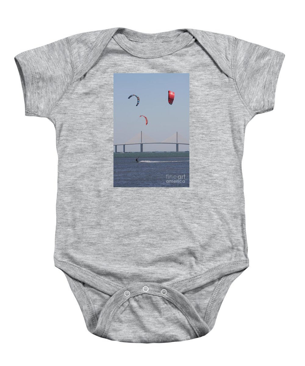 Bridge Baby Onesie featuring the photograph Kite Surfer And Skyway Bridge by Christiane Schulze Art And Photography