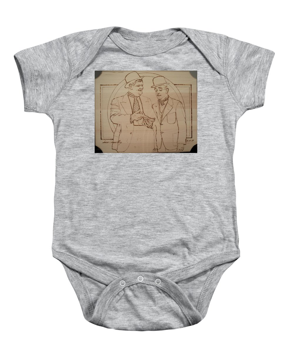 Pyrography Baby Onesie featuring the pyrography Laurel And Hardy - Thicker Than Water by Sean Connolly