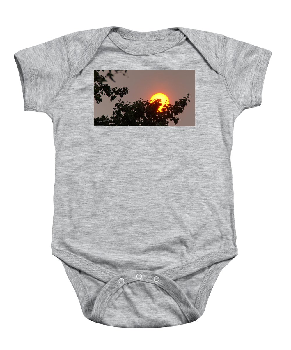 Sun Baby Onesie featuring the photograph Leaves Cradling Setting Sun by Mick Anderson
