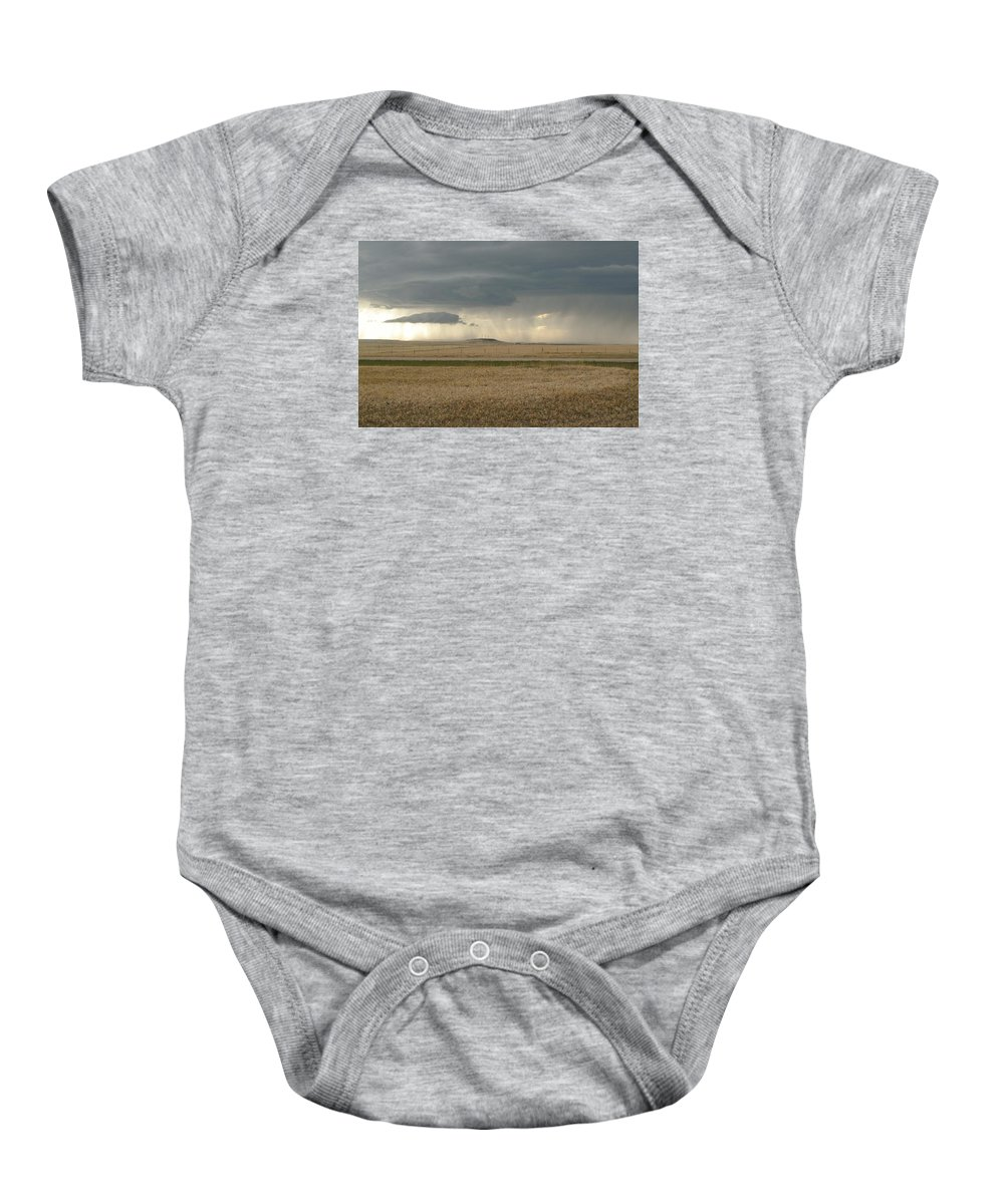 Open Range Baby Onesie featuring the photograph Light Near The End Of The Storm by Susan McMenamin