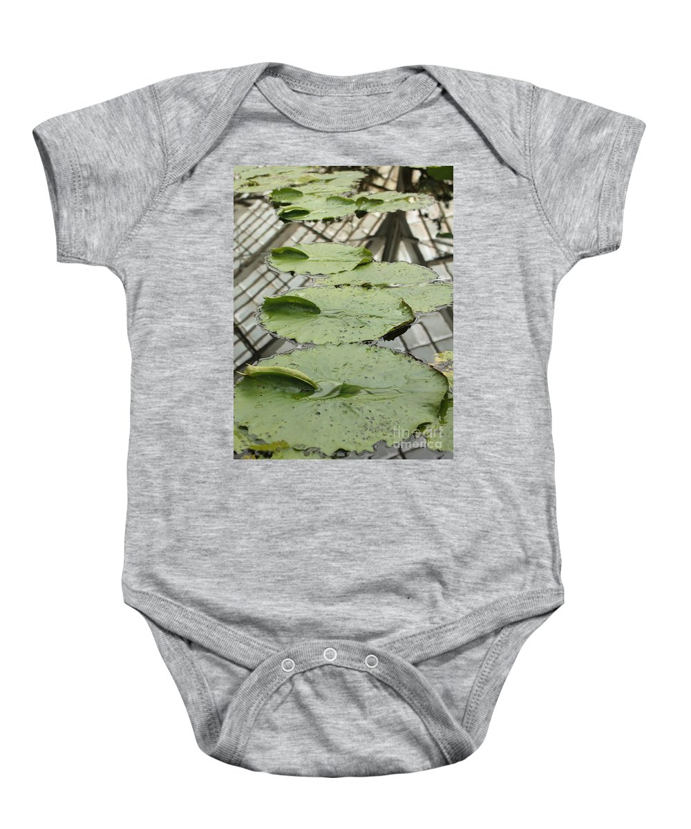 Lily Pads Baby Onesie featuring the photograph Lily Pads With Reflection Of Conservatory Roof by Carol Groenen