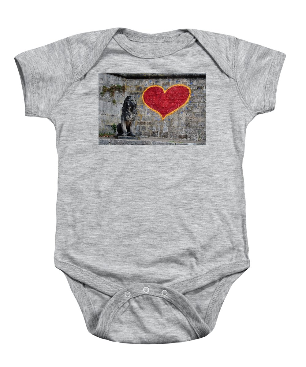 Statue Baby Onesie featuring the photograph Lionheart by Thomas Marchessault