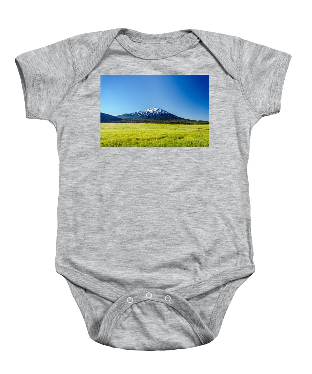 Mountain Baby Onesie featuring the photograph Lush Green Meadow And Mount Bachelor by Jess Kraft