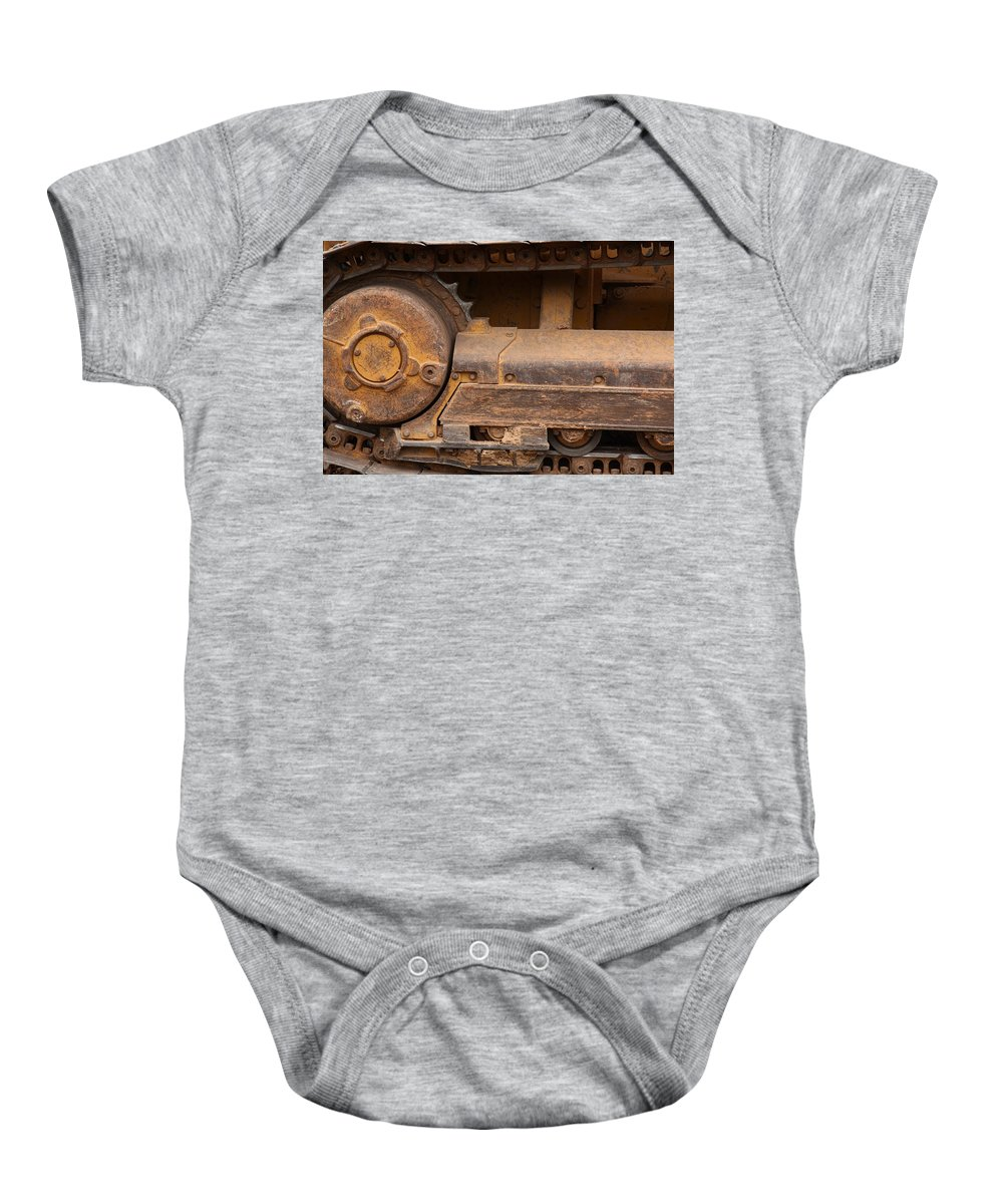 Wheel Baby Onesie featuring the photograph Machinery by Melinda Fawver