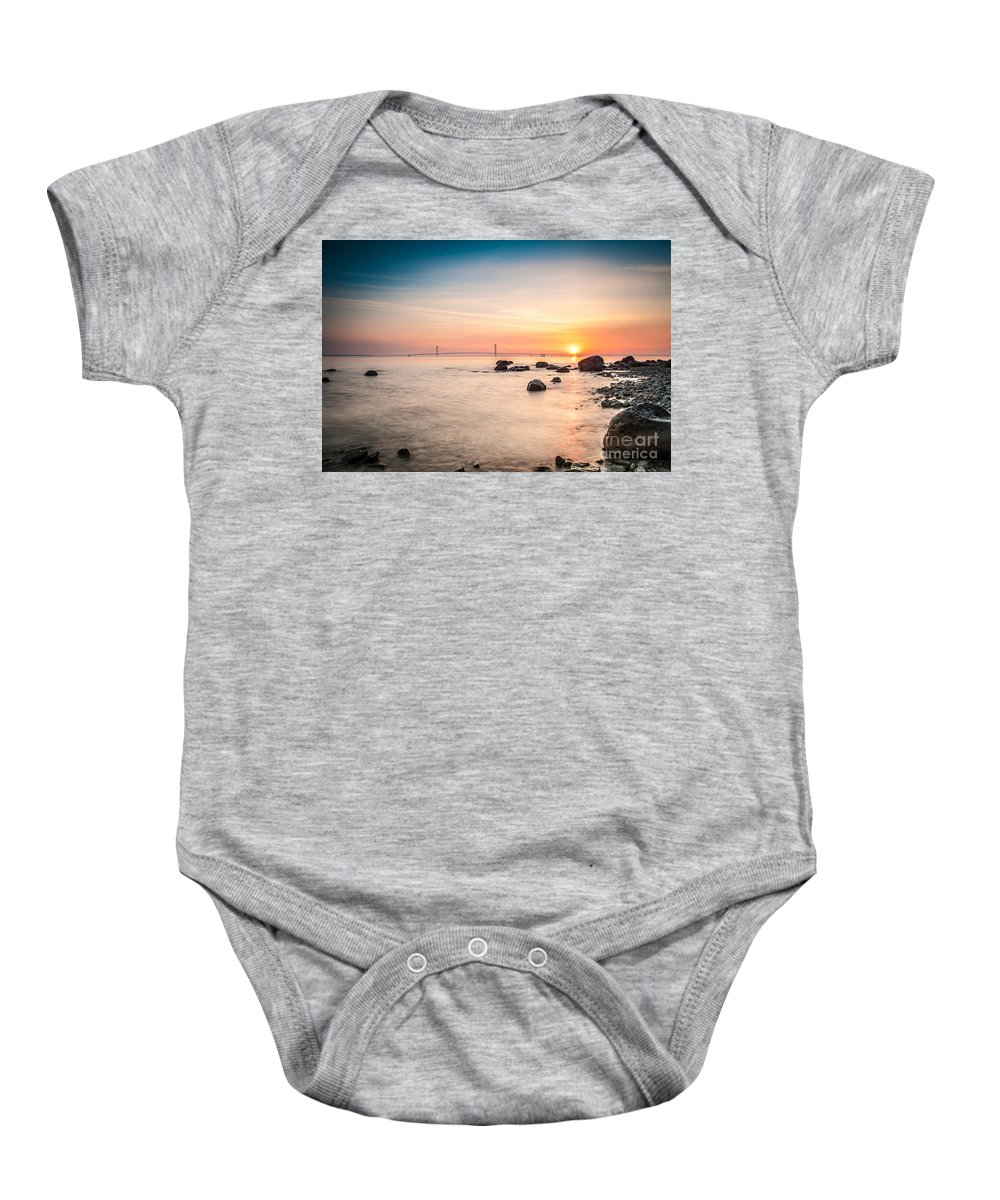 Bridge Baby Onesie featuring the photograph Mackinac Sunrise by Larry Carr