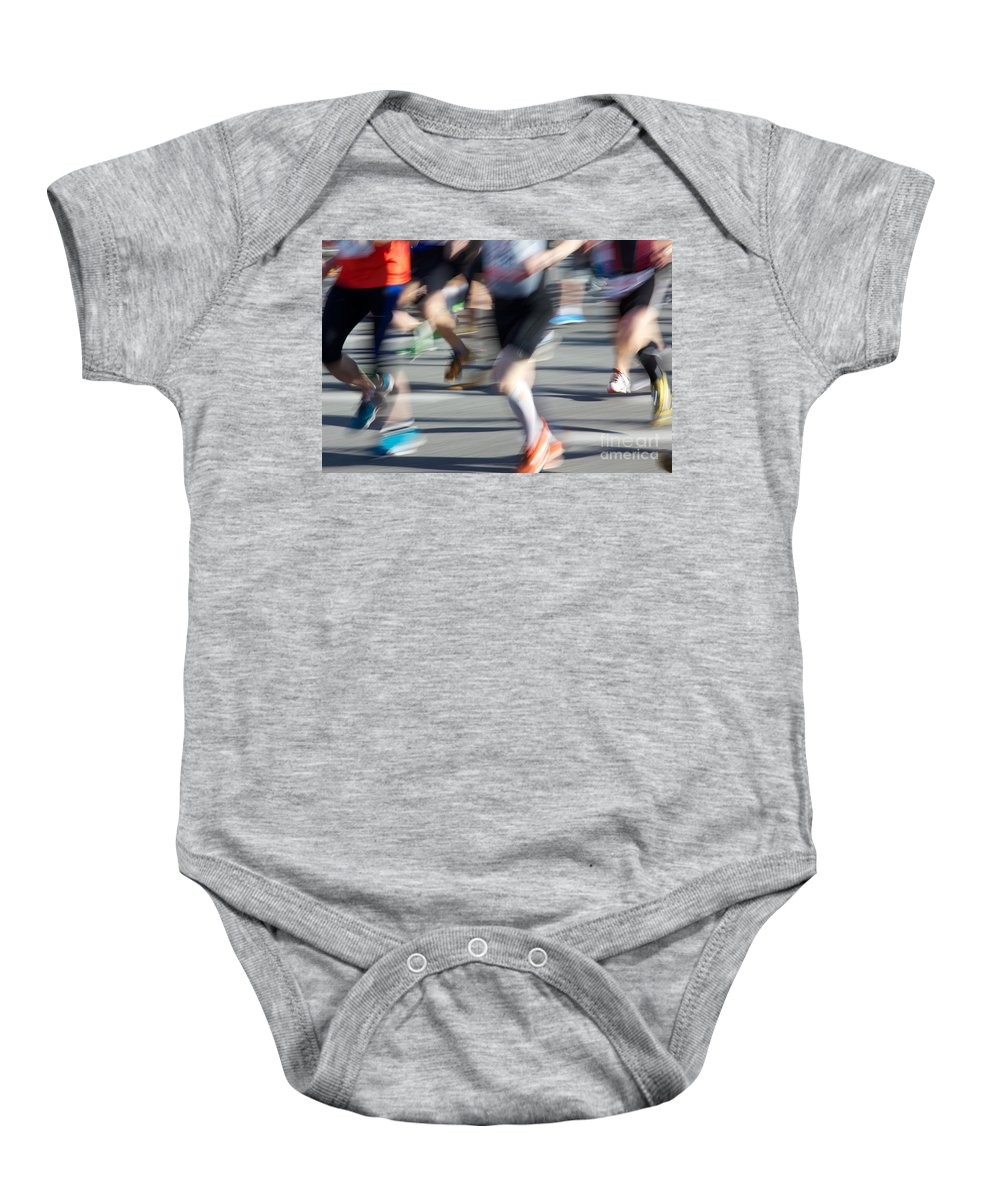 28th Baby Onesie featuring the photograph Marathon Runners by Jannis Werner
