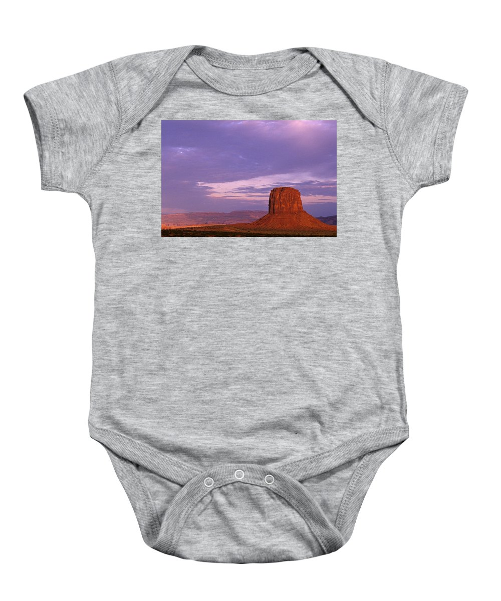 Adventure Baby Onesie featuring the photograph Monument Valley Red Rock Formations At Sunrise by Jim Corwin