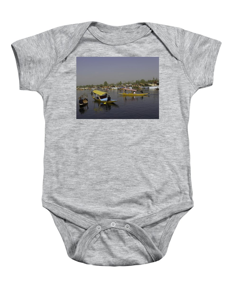 Beautiful Scene Baby Onesie featuring the photograph Multiple Number Of Shikaras On The Water Of The Dal Lake In Srinagar by Ashish Agarwal