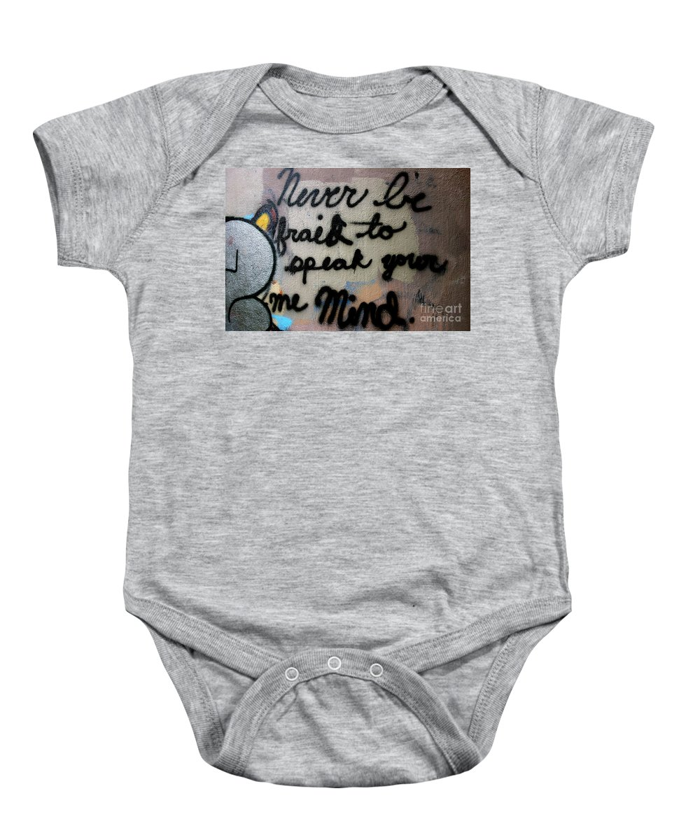 Graffitti Graffiti Baby Onesie featuring the photograph Never Be Afraid To Speak Your Mind by Jacqueline Athmann