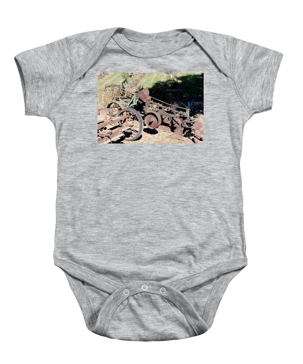 Mary Deal Baby Onesie featuring the photograph New Crop Antiquated Plow by Mary Deal