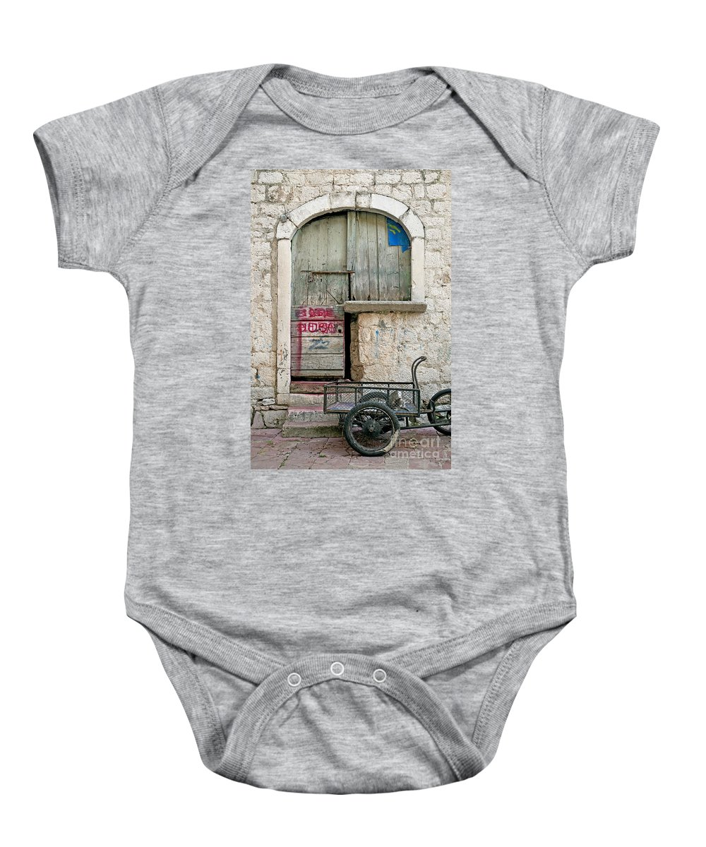 Architecture Baby Onesie featuring the photograph old town street in Kotor Montenegro by Jacek Malipan