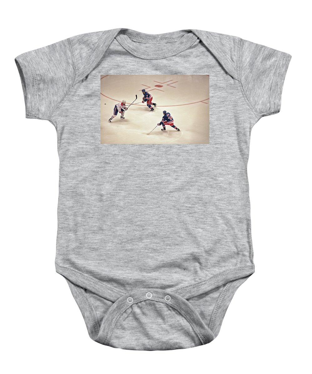 Hockey Baby Onesie featuring the photograph On The Offense by Karol Livote