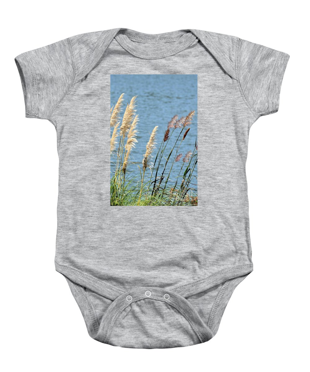 Pampas Baby Onesie featuring the photograph Pampas On The Lake by Maria Urso