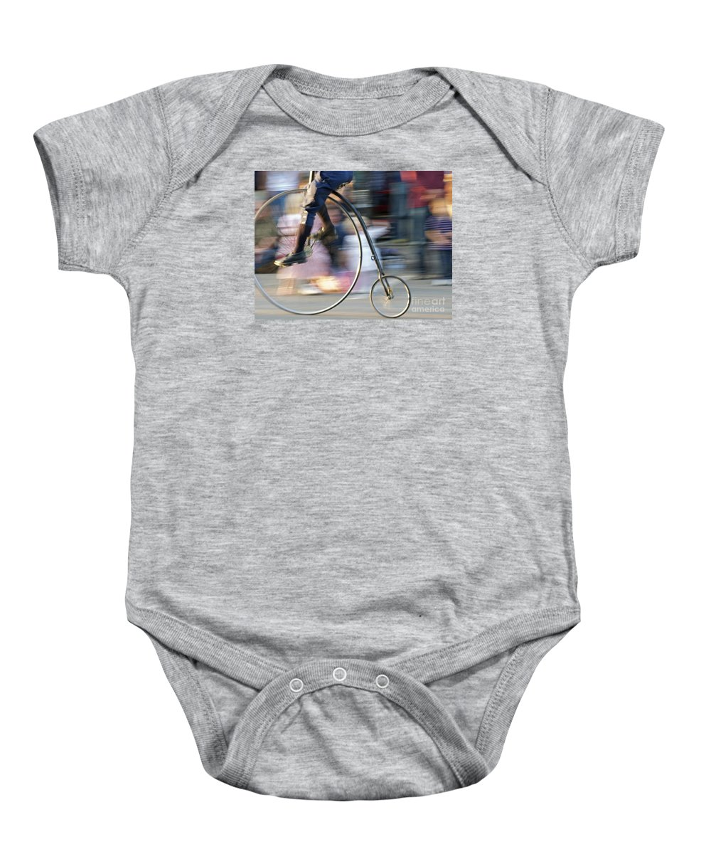 Bicycle Baby Onesie featuring the photograph Pedaling Past by Ann Horn