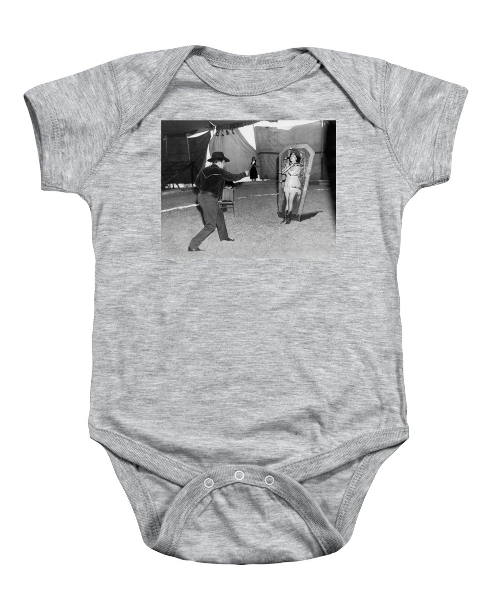 1945 Baby Onesie featuring the photograph Precision Knife Throwing by Underwood Archives