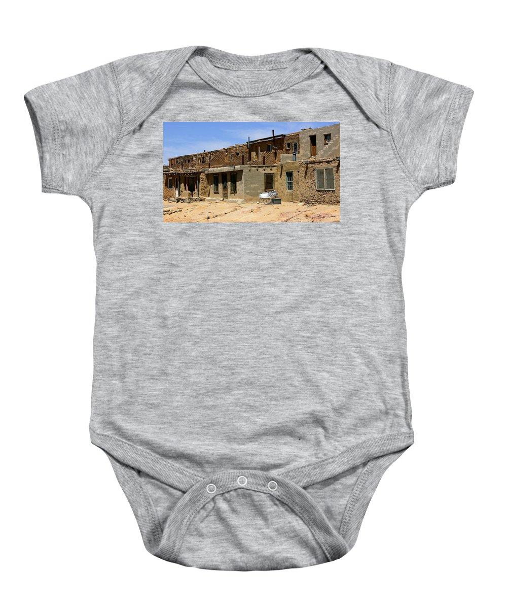 Pueblo Baby Onesie featuring the photograph Pueblo Yard Sale by Joe Kozlowski