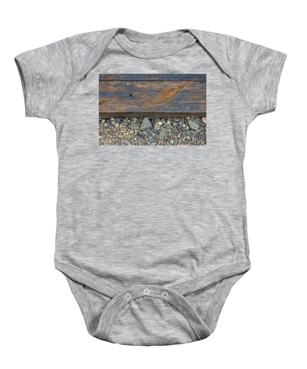 Railroad Baby Onesie featuring the photograph Railroad Track Closeup Background by Jit Lim