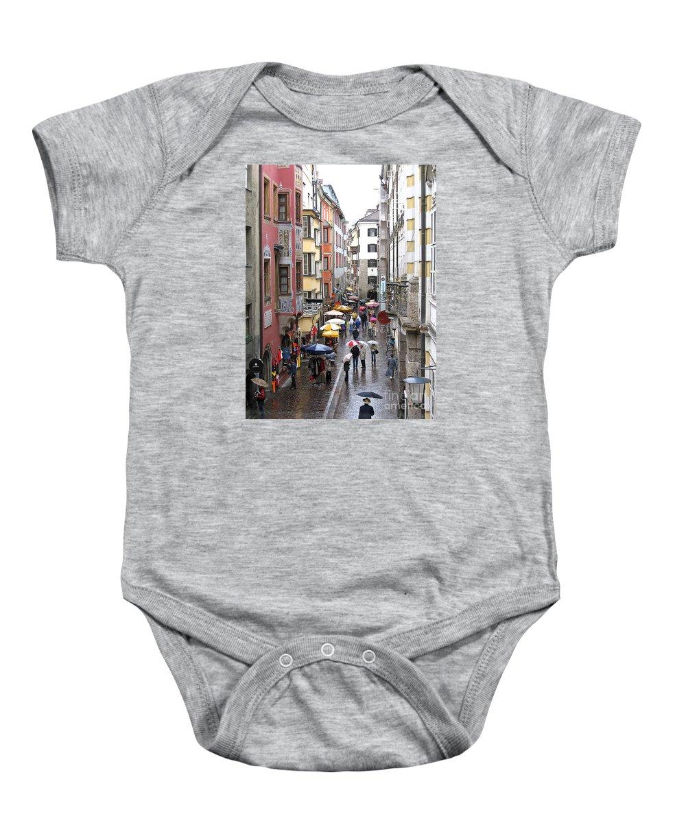 Innsbruck Baby Onesie featuring the photograph Rainy Day Shopping by Ann Horn