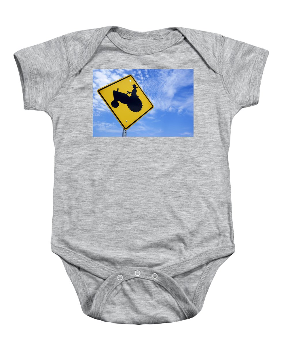 Sign Baby Onesie featuring the photograph Road Sign Tractor Crossing by Donald Erickson