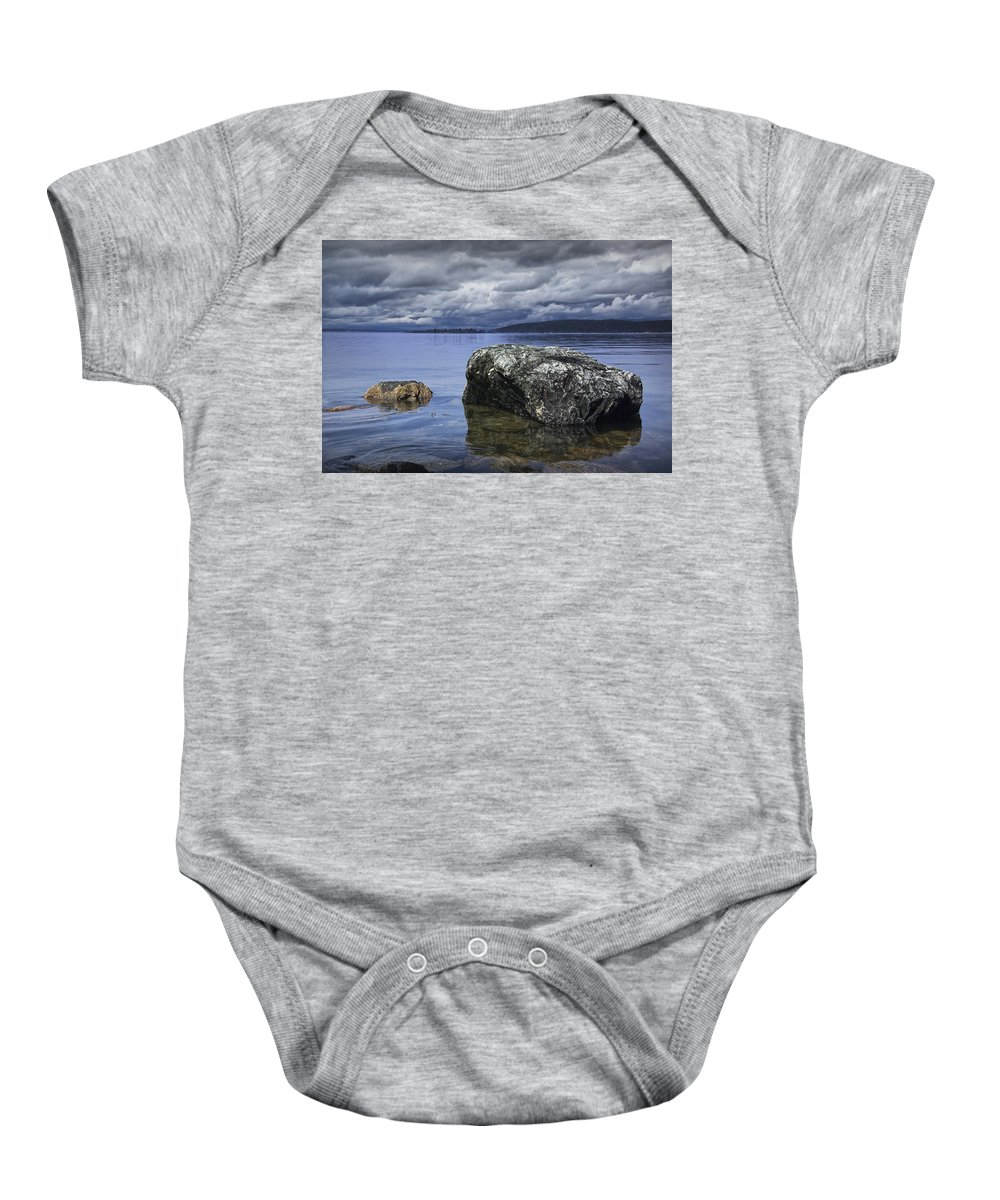 Art Baby Onesie featuring the photograph Rocks In The Water On A Lake In Acadia National Park by Randall Nyhof