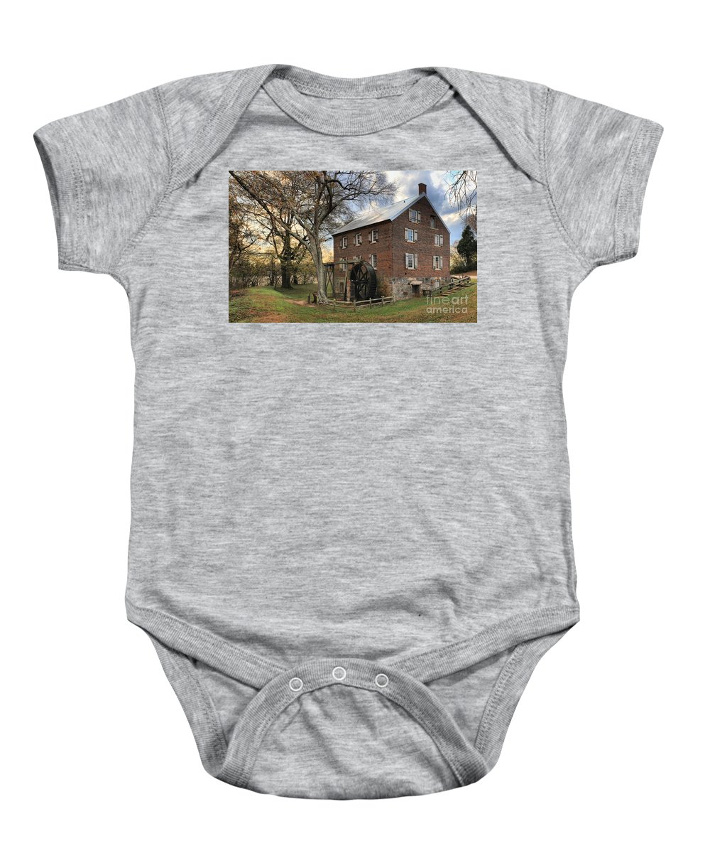 Kerr Mill Baby Onesie featuring the photograph Rowan County Grist Mill by Adam Jewell