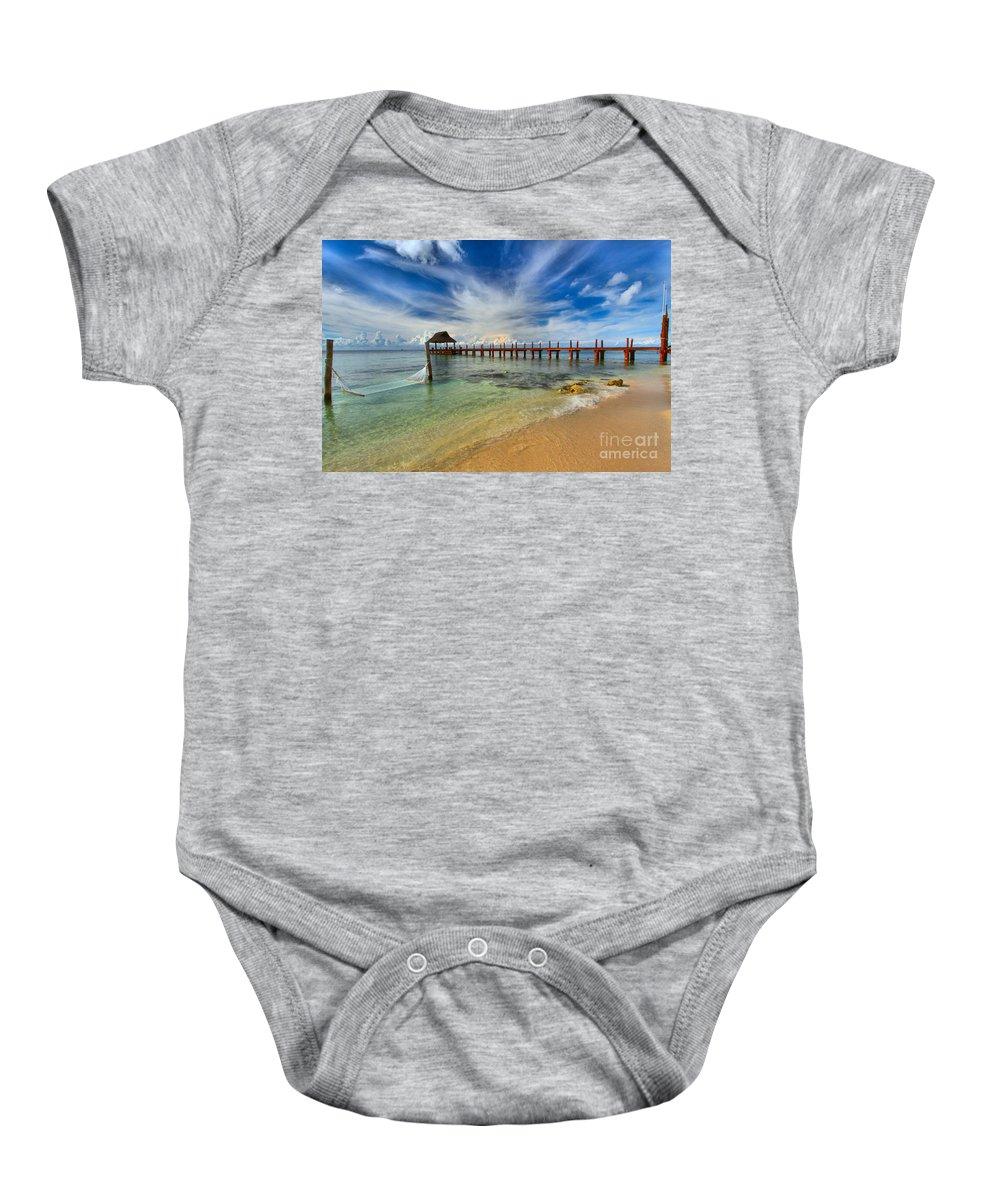 Caribbean Ocean Baby Onesie featuring the photograph Secrets Aura Pier by Adam Jewell