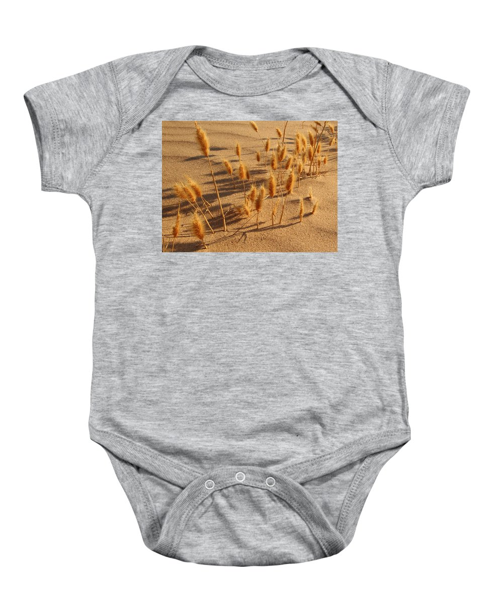 Brazos River Baby Onesie featuring the photograph Seed And Sand by Andrew McInnes
