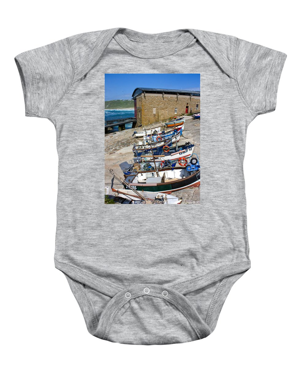 Sennen Cove Baby Onesie featuring the photograph Sennen Cove Fishing Fleet by Terri Waters