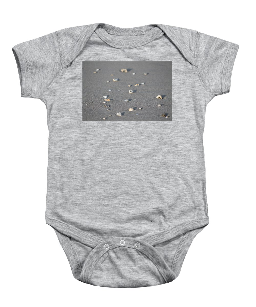 Beach Baby Onesie featuring the photograph Shells On A Beach by Catie Canetti