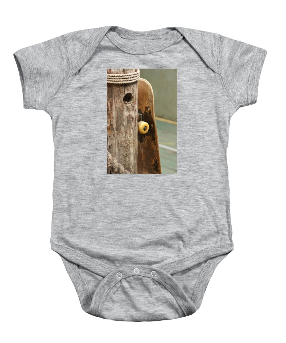 Cayucos Baby Onesie featuring the photograph Skateboard by Art Block Collections