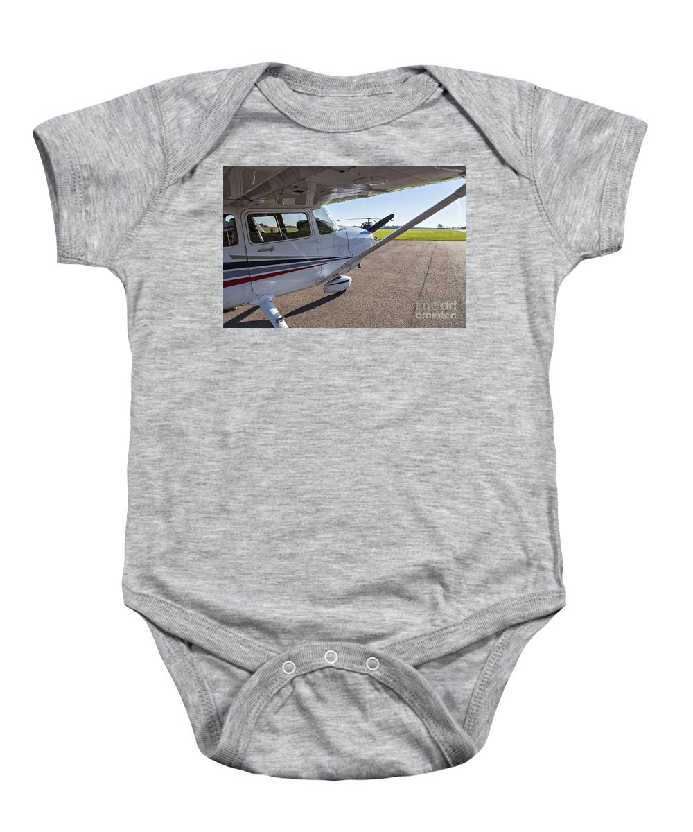 Plane Baby Onesie featuring the photograph Small Plane In Private Airport by Sophie McAulay