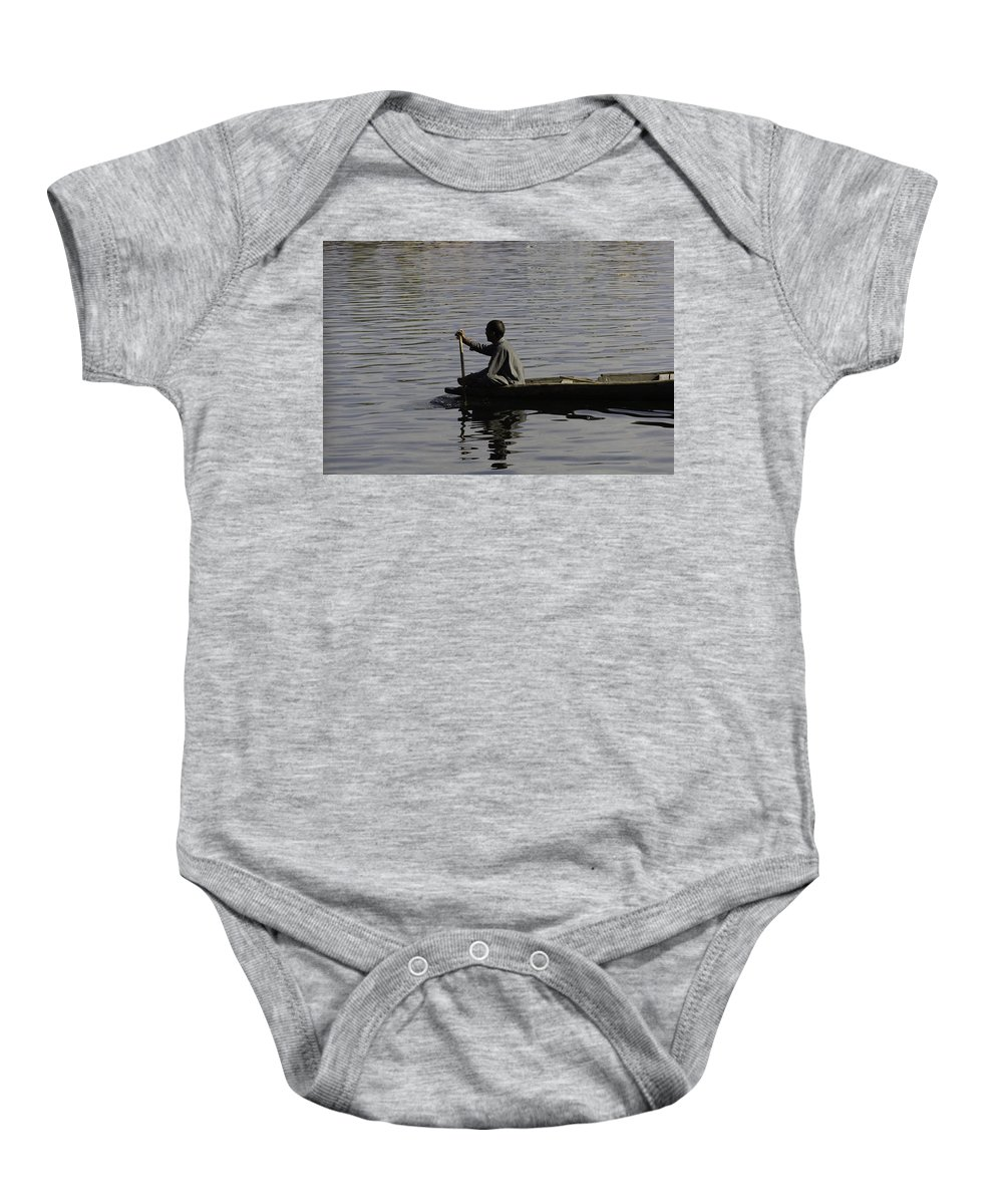 Beautiful Scene Baby Onesie featuring the photograph Splashing In The Water Caused Due To Kashmiri Man Rowing A Small Boat by Ashish Agarwal