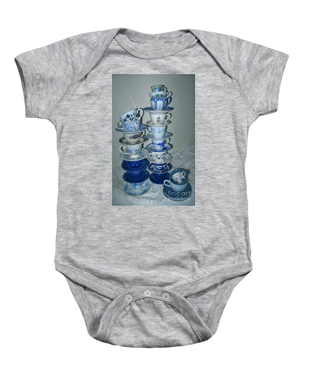 Stack Of Blue Tea Cups Baby Onesie featuring the photograph Stack Of Blue Teacups by Nancy Patterson