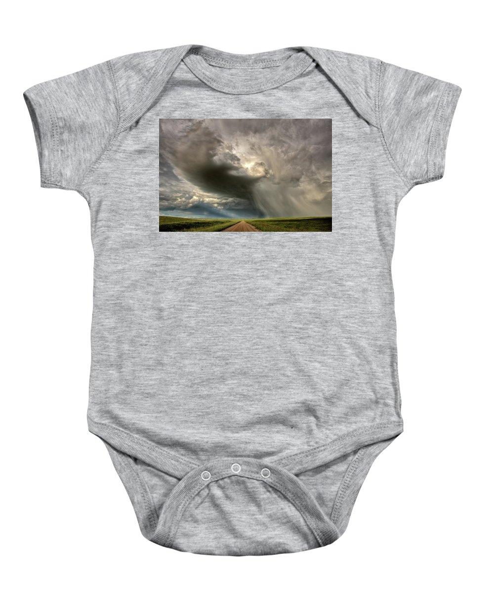 Nature Baby Onesie featuring the digital art Storm Clouds Prairie Sky Saskatchewan by Mark Duffy
