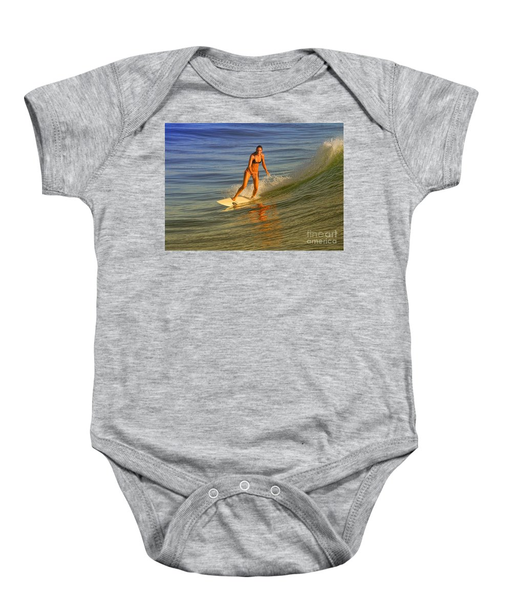 Surfing Baby Onesie featuring the photograph Surfer At Sun Glow by Deborah Benoit