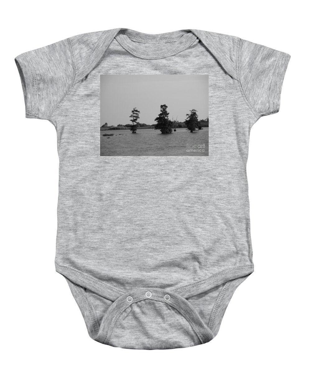 Water Lilly Baby Onesie featuring the photograph Swamp Tall Cypress Trees Black And White by Joseph Baril
