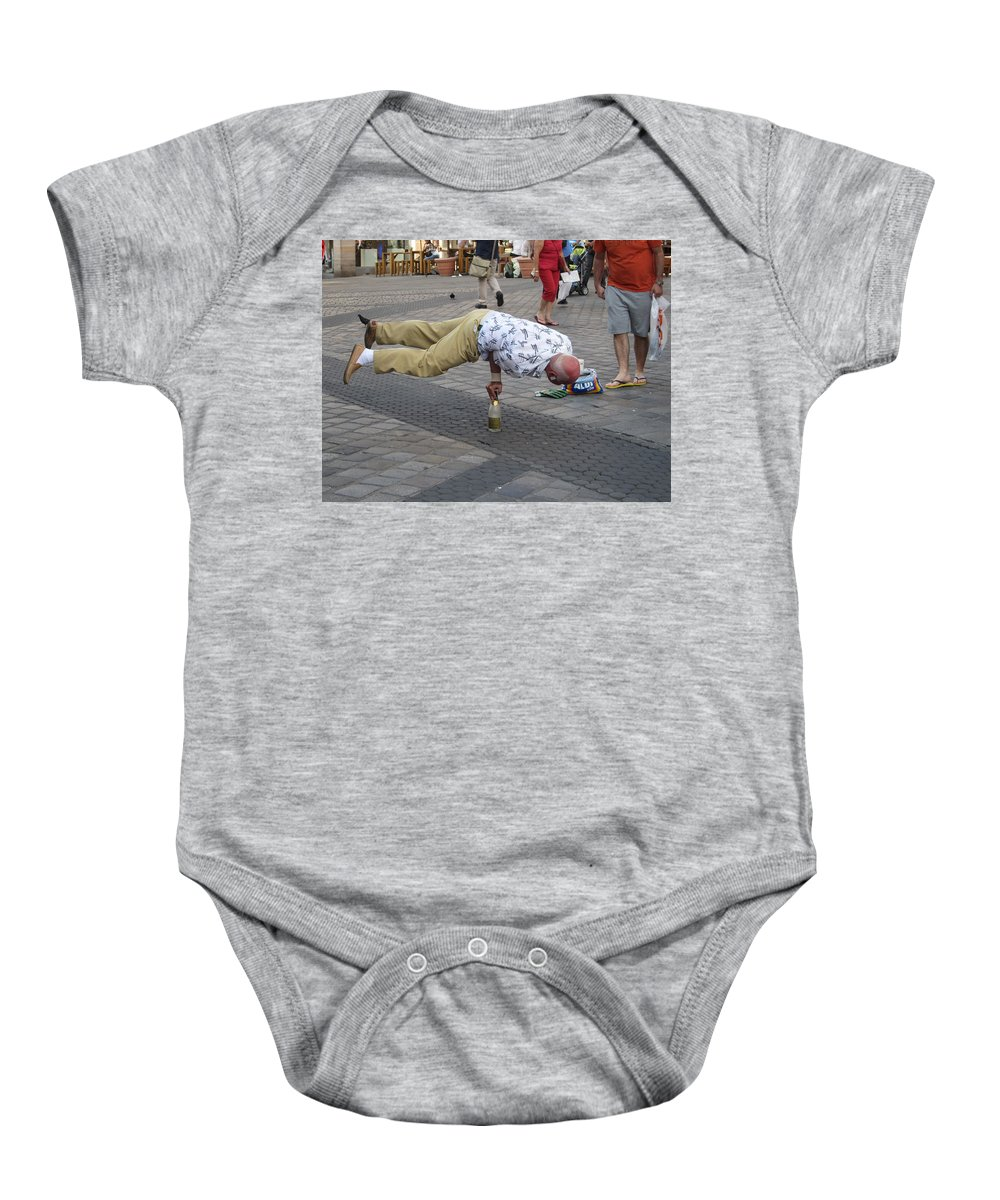 Street Performer Baby Onesie featuring the photograph The Balancing Act by Pema Hou