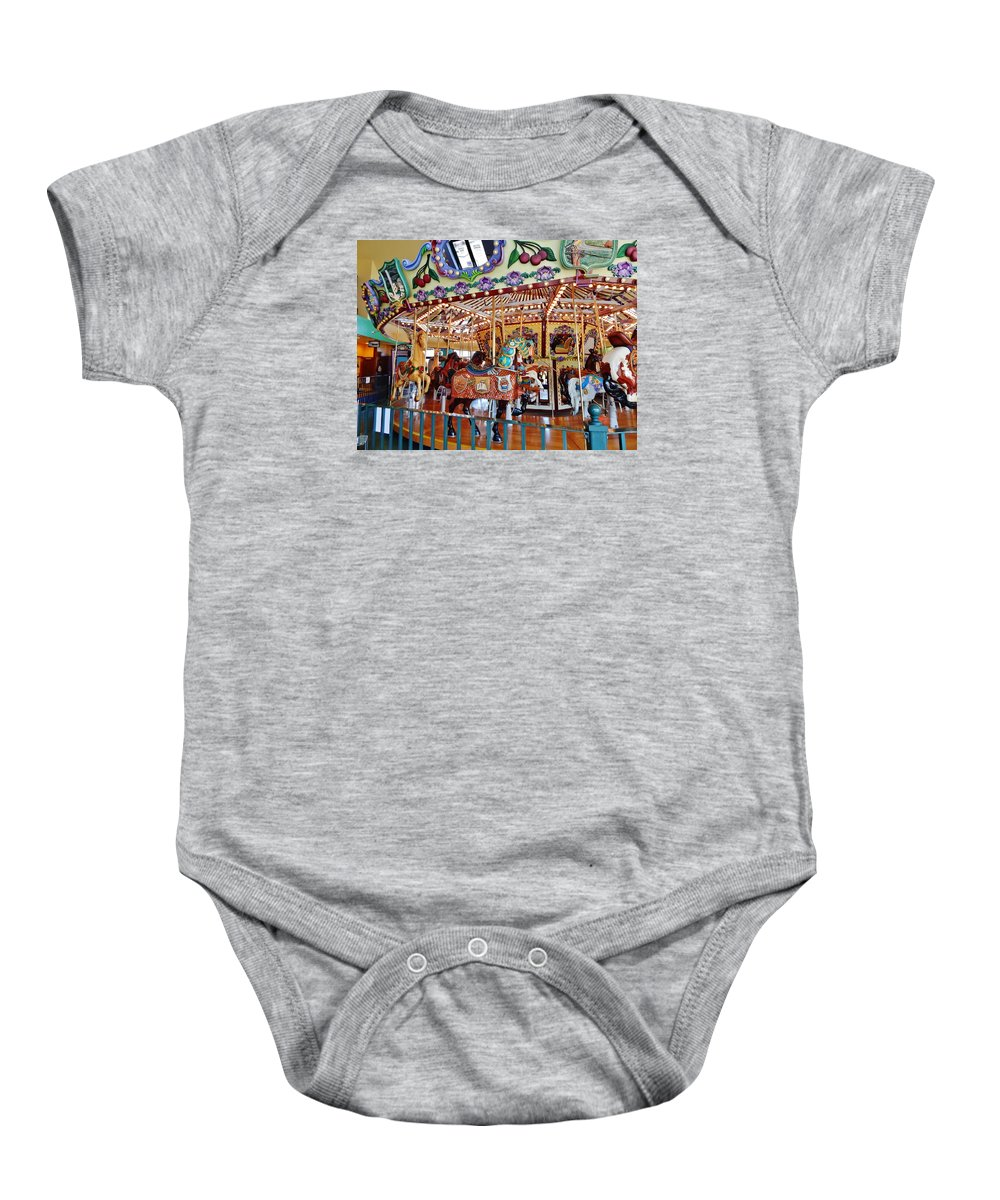 Carousel Baby Onesie featuring the photograph The Carousel Ride by VLee Watson